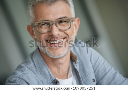Middle-aged guy with trendy eyeglasses #1098057251