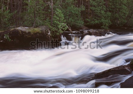 Long exposure of rapids along the Kopka River.