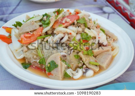 close up spicy mix salad with seafood and fresh vegetable #1098190283