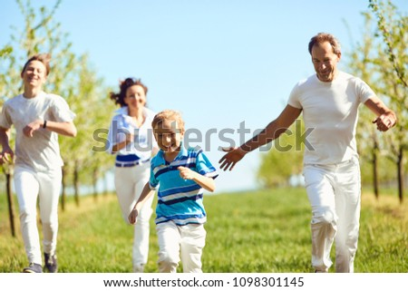 Happy family having fun walking in the garden in spring, summer. #1098301145