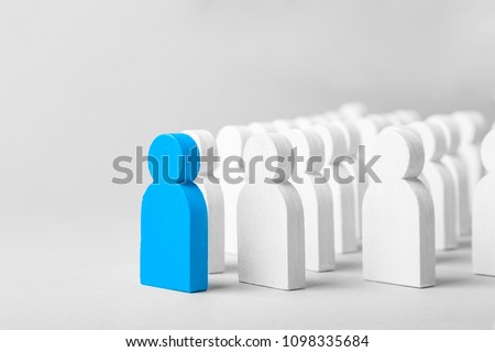 Concept leader of the business team indicates the direction of the movement towards the goal. Crowd of white men goes for the leader of the blue color #1098335684