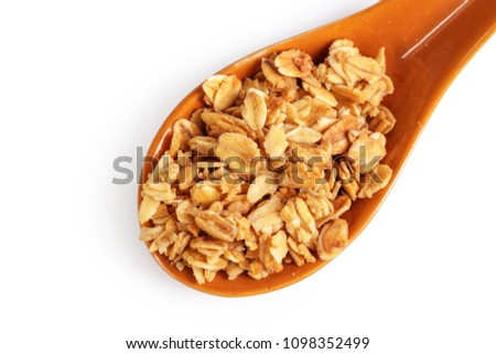 Spoon with granola on white background #1098352499