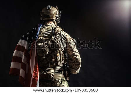 Soldier holding machine gun with national flag #1098353600