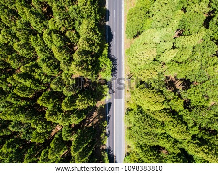 Aerial photograph of a straight road in the mountain. #1098383810
