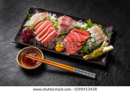 japanese foods sashimi (raw sliced fish, shellfish or crustaceans)  #1098413438