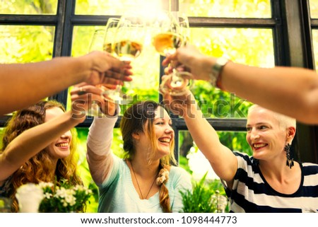 Female friends celebrating with wine #1098444773