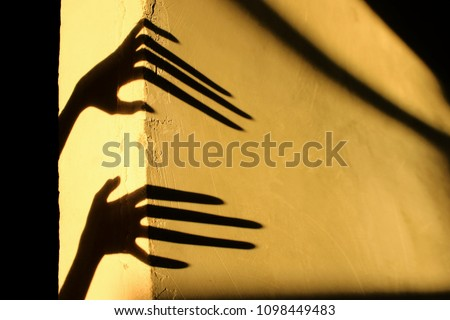 Strange Shadows On The Wall.Terrible Shadows. Abstract Background. Black Shadows Of A Big Hands On The Wall. Silhouette Of A Hands On The Wall. Nightmares. Scary Dreams. #1098449483