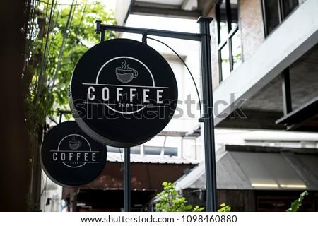 Black sign outside a restaurant mockup