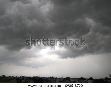 Photo of black and dusk clouds during a storm.Dramatic view of lightning storm.Very lovely cloudy and rainy weather. cloud and sky.