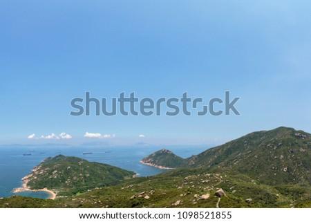 Mountain and ocean in Hong Kong #1098521855