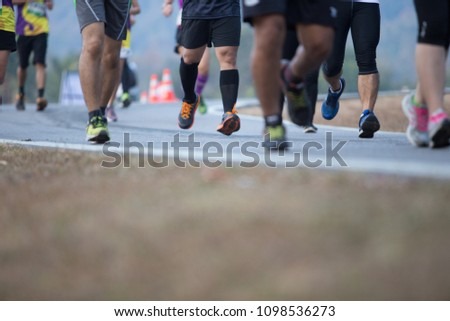 Group of people running race marathon #1098536273