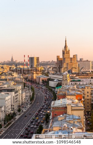 MOSCOW, RUSSIA - 23 MAY 2018: Evening view of The Sadovaya-Kudrinskaya street and high-rise building on Kudrinskaya square #1098546548