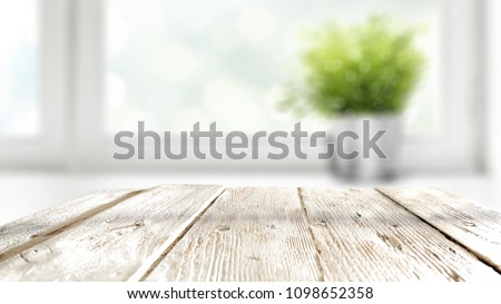 Table background of white color with window and summer time  #1098652358