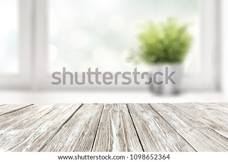 Table background of white color with window and summer time  #1098652364