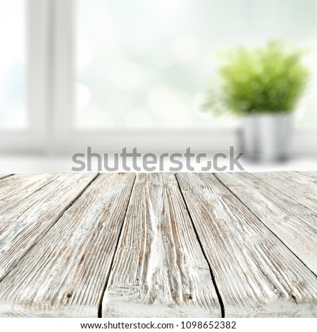 Table background of white color with window and summer time  #1098652382