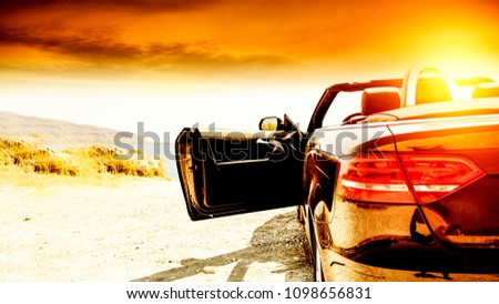 Summer car on road and sunset time  #1098656831