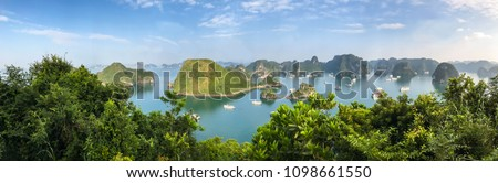 Panorama of Ha Long Bay islands, tourists enjoy boat cruise and seascape, Ha Long, Vietnam, Asia. UNESCO world heritage site, popular landmark and landscape, famous destination in Halong, Vietnam. Royalty-Free Stock Photo #1098661550