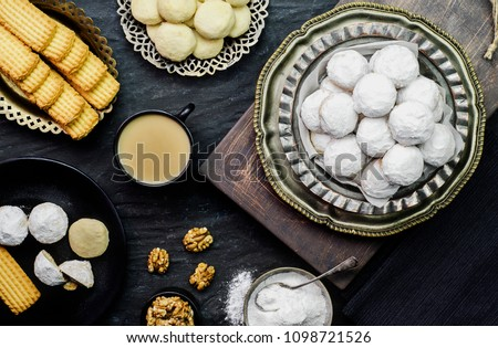 Cookies for celebration of  El- Fitr Islamic Feast (The Feast that comes after Ramadan).Varities of Eid Al- Fitr sweets (Kahk- Gorayeba- Biscuits).Served with cup of tea with milk. #1098721526