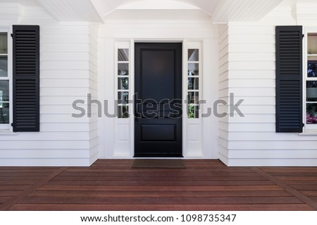 Black front door of classic style home in Oregon. Royalty-Free Stock Photo #1098735347