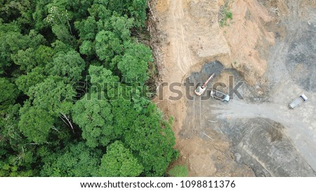 Deforestation aerial photo. Rainforest jungle in Borneo, Malaysia, destroyed to make way for oil palm plantations  #1098811376