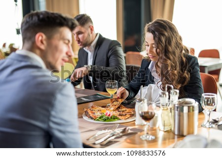 Group of business friends on a vacation in a hotel room, enjoying a nice dinner. #1098833576