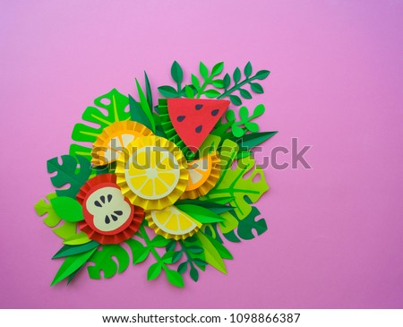 Fruit made of paper. Pink background. There's room for writing.Tropics. Flat lay.Pineapple, watermelon, Apple, lemon and orange.
