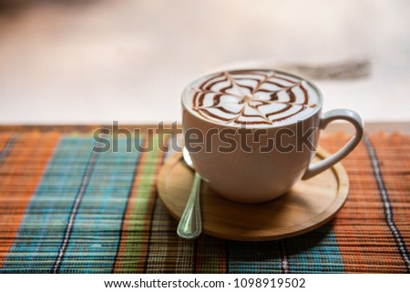 Cappuccino cup on bar table near window in the restaurant #1098919502