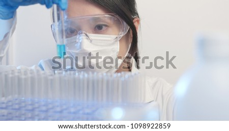 Woman doing the experiment of test tube with liquid  #1098922859