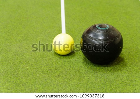Bowl and jack on an indoor bowls carpet #1099037318