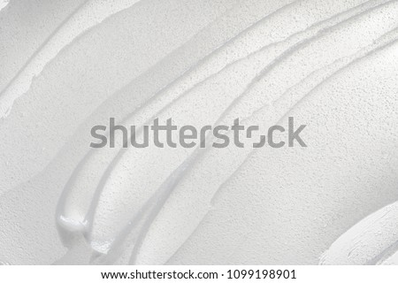 White smear of cosmetic cream isolated on white background. Creamy foundation texture isolated. Smear of face cream isolated. Texture of cream background #1099198901