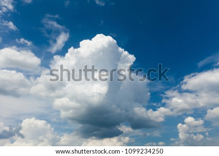 Beautiful sunny white cumulus on blue sky background. #1099234250