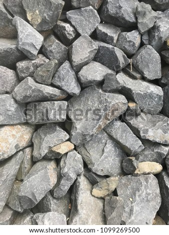 Surface of several stones in a dry creek #1099269500