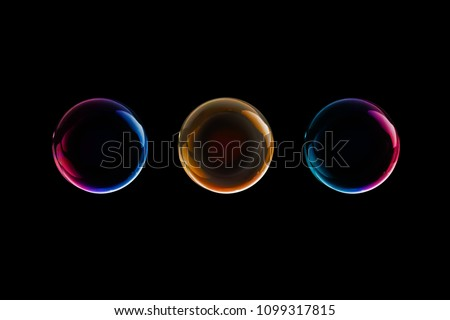BUBBLES ISOLATED ON BLACK BACKGROUND Royalty-Free Stock Photo #1099317815