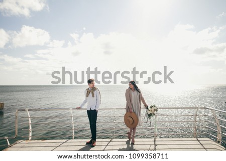 Young couple on beach #1099358711