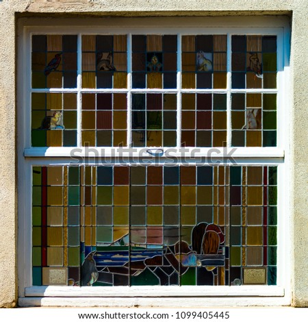 Beautiful old windows with colorful glasses, leaded-pane for home #1099405445