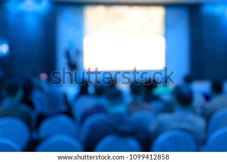 Blur of seminar room in convention hall , hotel or big room . blue tone #1099412858