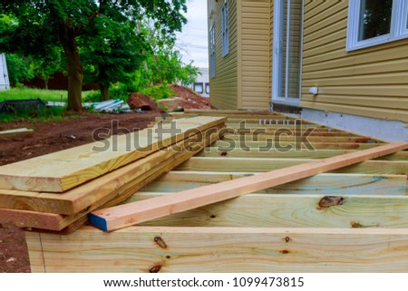 A new wooden, timber deck being constructed #1099473815