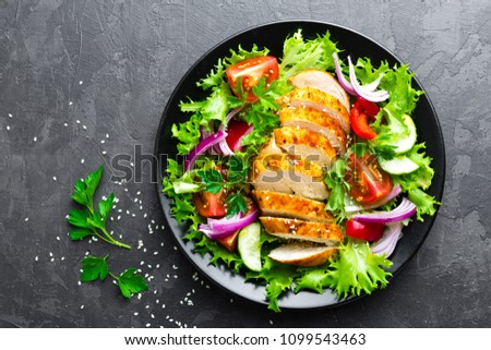 Salad with chicken meat. Fresh vegetable salad with chicken breast. Meat salad with chicken fillet and fresh vegetables on plate #1099543463