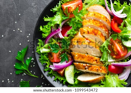 Salad with chicken meat. Fresh vegetable salad with chicken breast. Meat salad with chicken fillet and fresh vegetables on plate #1099543472