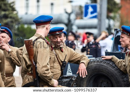 People in military uniform in honor of the Victory Day holiday. Military historical society, reconstruction of the appearance of fighters of the Second World War II. Rostov-on-Don. Russia 9.5.2018 #1099576337