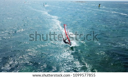 Vouliagmeni, Athens / Greece - May 27 2018: Aerial drone bird's eye view photo of competition surf race in wavy clear waters of Athenian riviera, Attica #1099577855