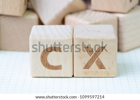 Customer Experience concept, cube wooden block with alphabet CX, important of user centric in recent world business, product and service. #1099597214