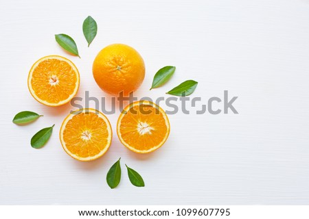 Fresh orange citrus fruit with leaves isolated on white background. Juicy and sweet and renowned for its concentration of vitamin C #1099607795