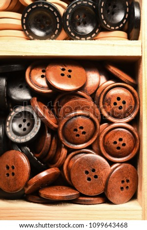close up of beautiful colored wooden buttons for background #1099643468