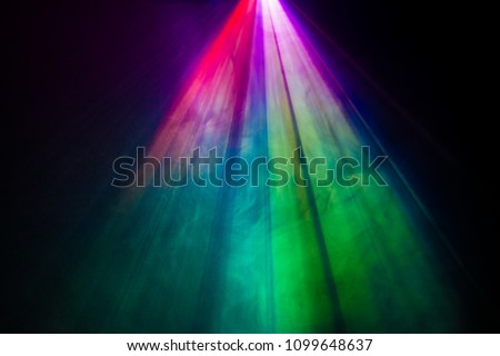 beautiful rainbow color wide lens projector with light beam for movie and cinema at night . smoke texture spotlight . screening for multimedia . black background . #1099648637