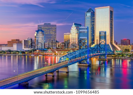Jacksonville, Florida, USA downtown skyline at dusk over St. Johns River.