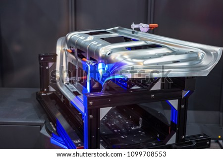Robotic system 3d scan. A complex metal part is scanned by light rays. #1099708553