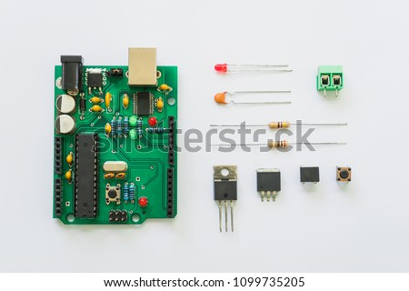 Top view of electronics component such as PCB board, resistor, ICs, capacitor, switch, and connector. #1099735205
