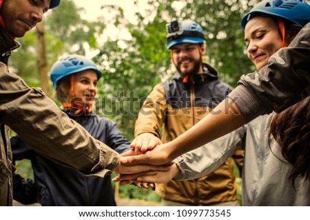 Group of hikers stacking hands #1099773545