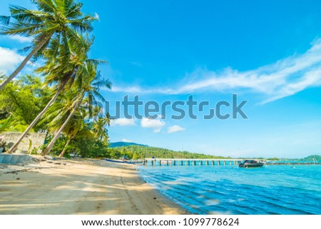 Beautiful tropical beach and sea with coconut palm tree in paradise island #1099778624